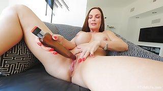 Mature brunette bombshell Diamond pounds herself with a dildo