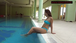 Downcast eyed and red haired Russian mermaid Mia Ferrari in her underwater show