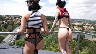 Adventurous and reckless bitch Charlotte Sartre poses on cam on the roof