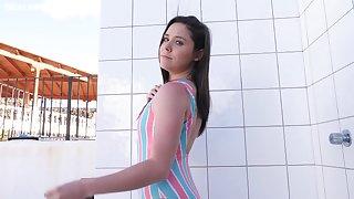 Topless bikini girl Ella is taking poolside shower